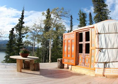 Travelling Light Yukon Yurt for Rent with a deck and mountain views